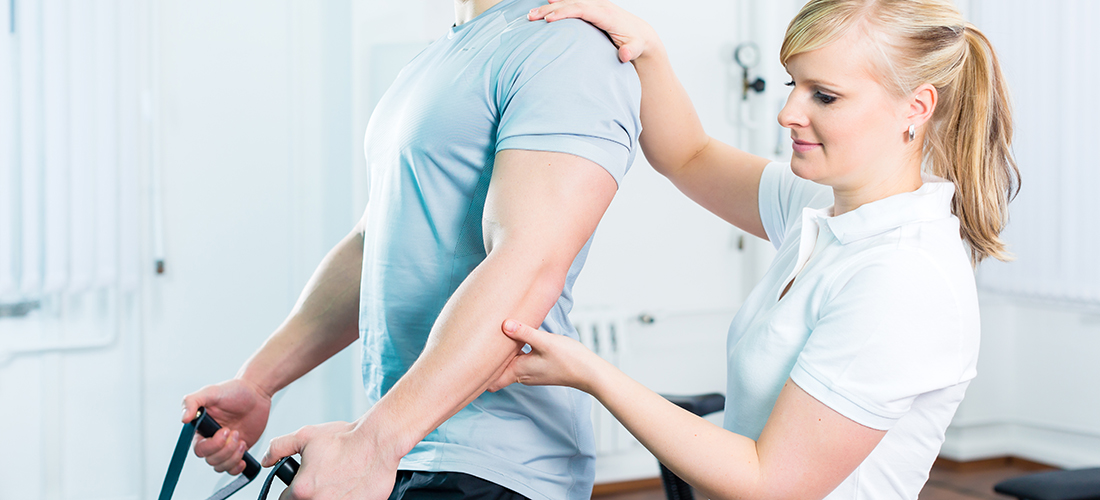 Physiotherapist excercising patient in practice